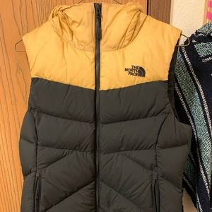 The North Face black and gold vest